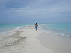 Walking down a sand back in the Maldives