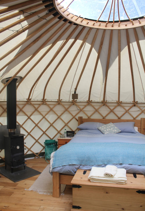 Inside the yurt at Round the Woods